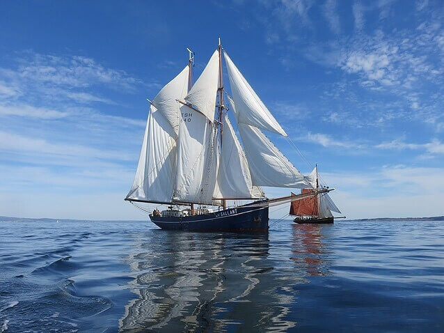 Sailing vessel at sea carrying cargo