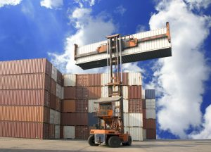 A loaded shipping container being weighed and lifted at the port of loading.